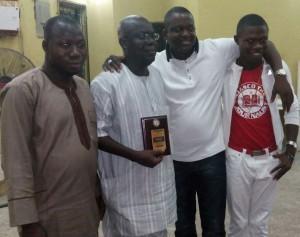 *Dimeji displaying his award in company of Adejobi and others.