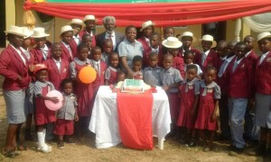 *Fadugba with Ayodele and pupils of the school cutting the Christmas cake.