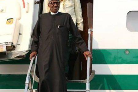 Buhari arrives from UK into Osinbajo, others' warm embrace